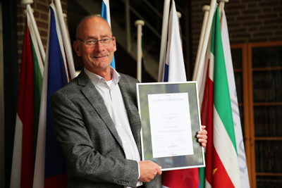 Mr. Marcel van der Ham, Dean of Business School Netherlands presents the CEDEO certificate
