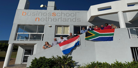 dba-conference-attendees-on-steps-outside-BSN-office